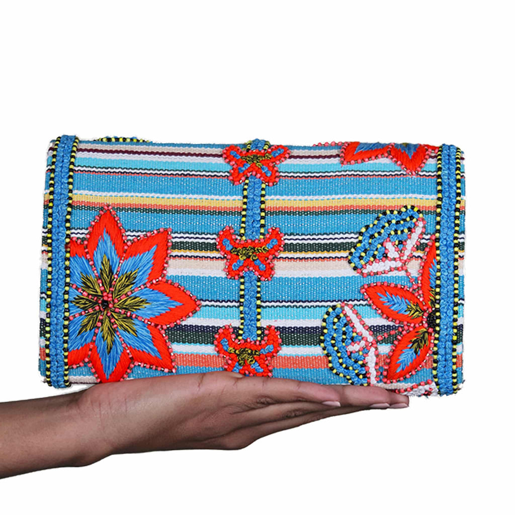 hand holding akbar delights mykonos clutch bag backside