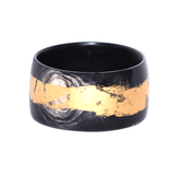 Black and gold Ama Bracelet by Adèle Dejak