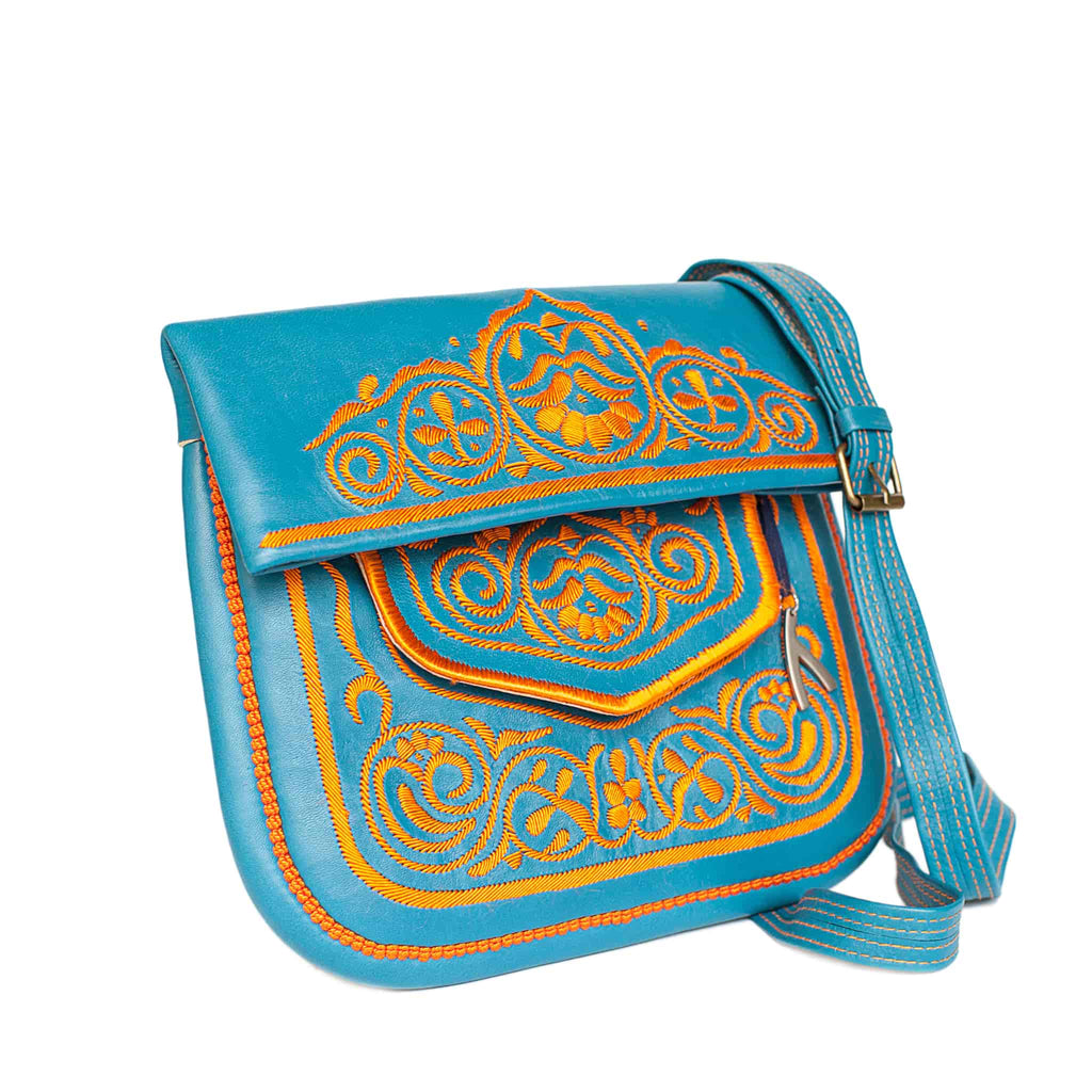 side view of turquoise and orange embroidered ABURY Leather Berber Shoulder Bag