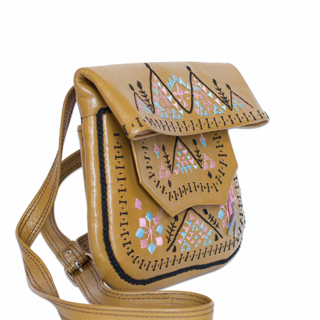 side view of beige pink and baby blue patterned ABURY Leather Berber Shoulder Bag