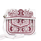 front view of handmade white and raspberry embroidered ABURY Leather Berber Shoulder Bag