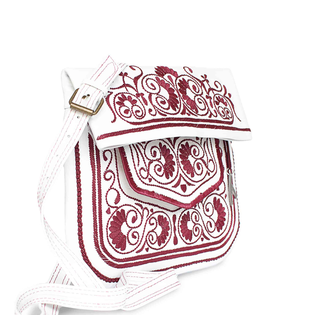 side view of white and raspberry embroidered ABURY Leather Berber Shoulder Bag