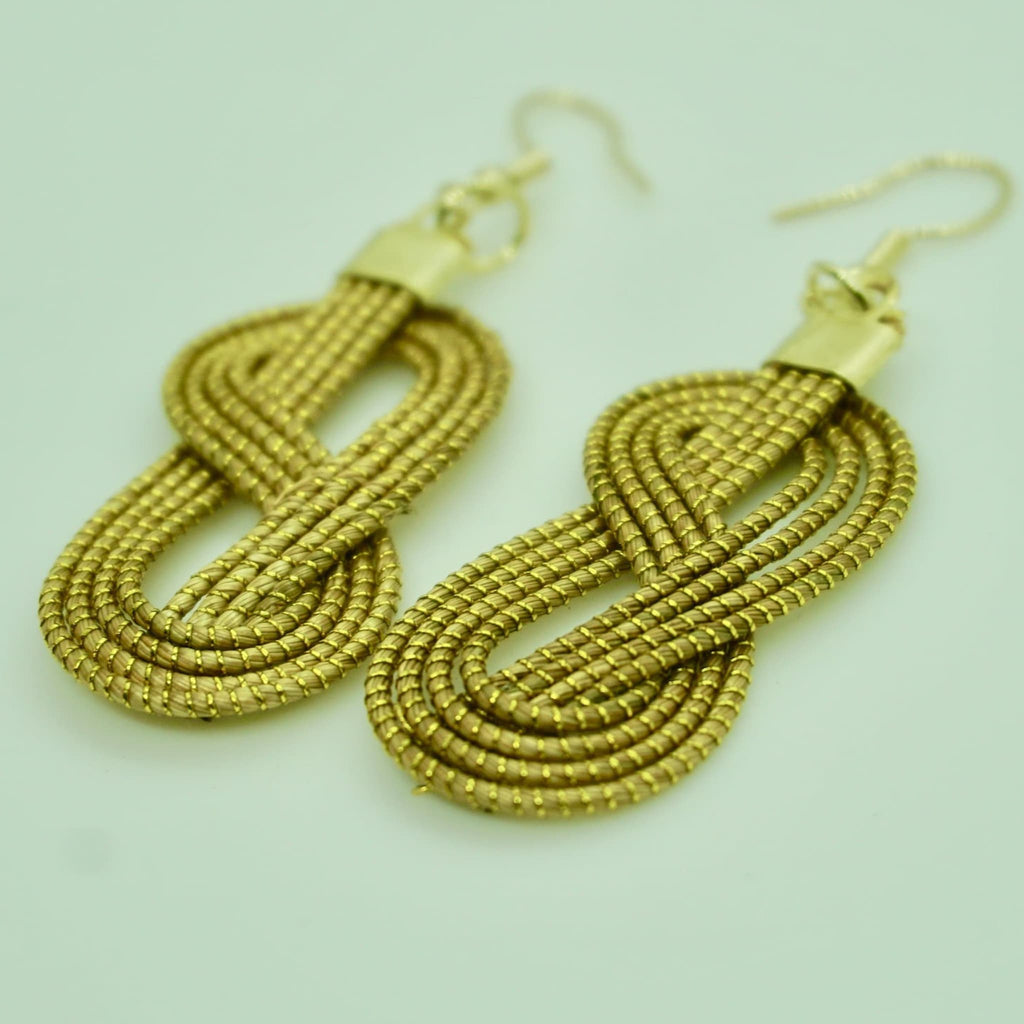 Ararê golden grass earrings by she is from the jungle