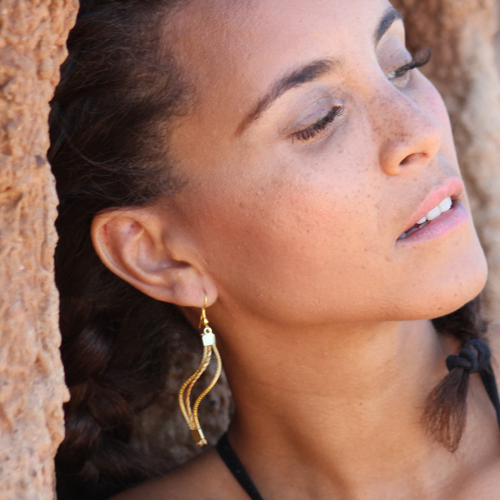 model using Olinda golden grass earrings by she is from the jungle