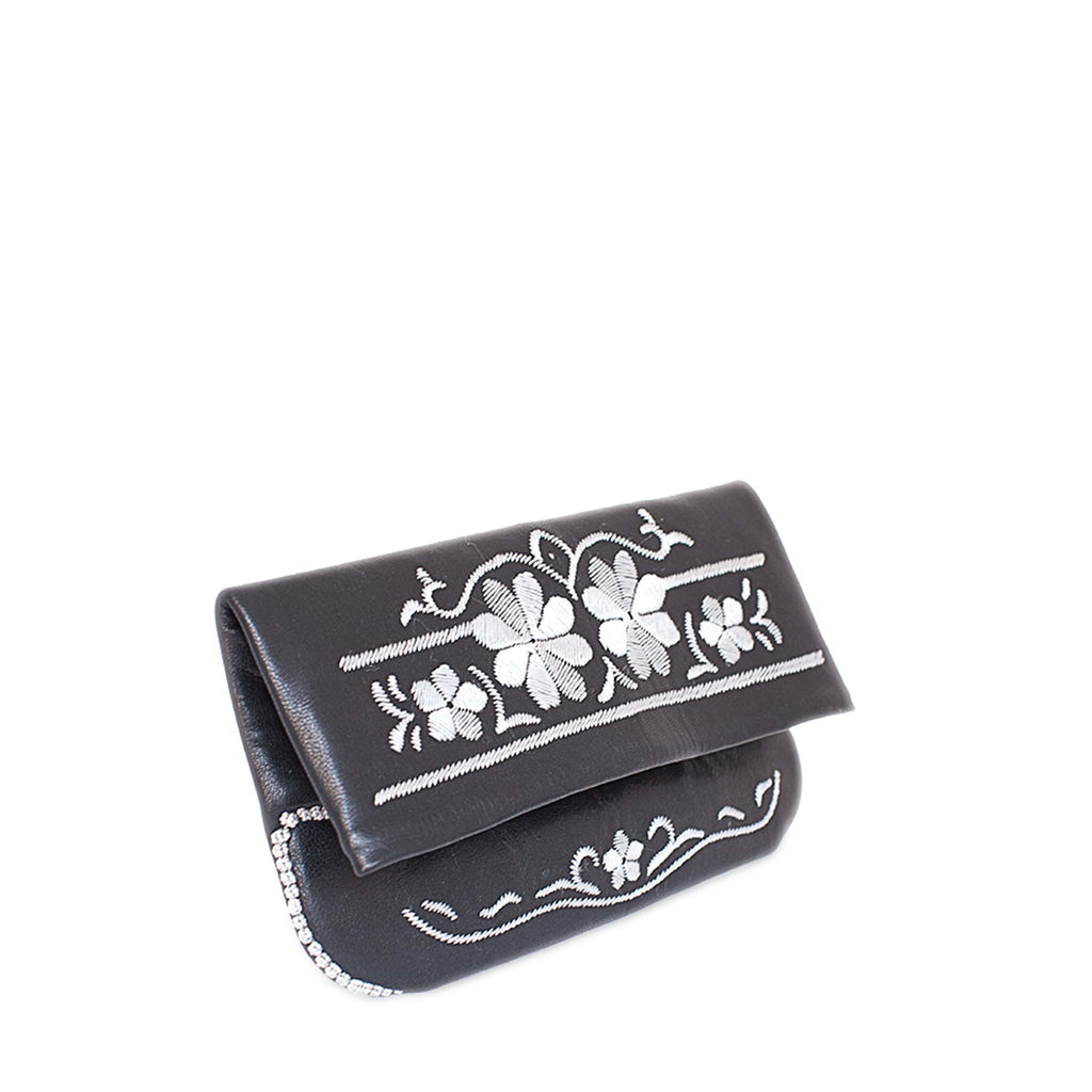 front view of side view of black and silver floral embroidered abury leather clutch bag