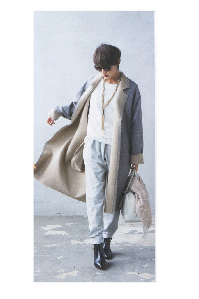model with short dark hair in coat wearing Hanae Leather Necklace - Gold