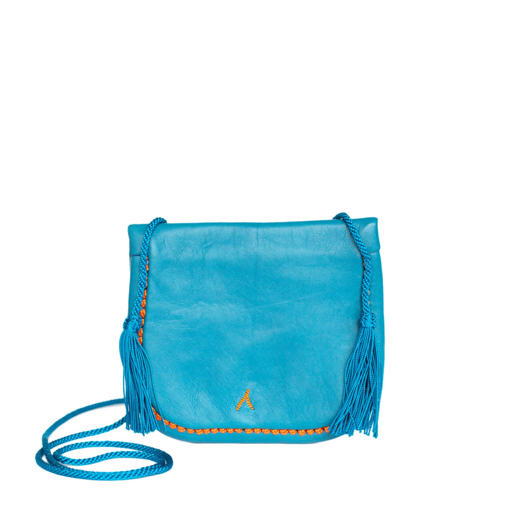 back view of eco-friendly turquoise and orange abury mini berber bag