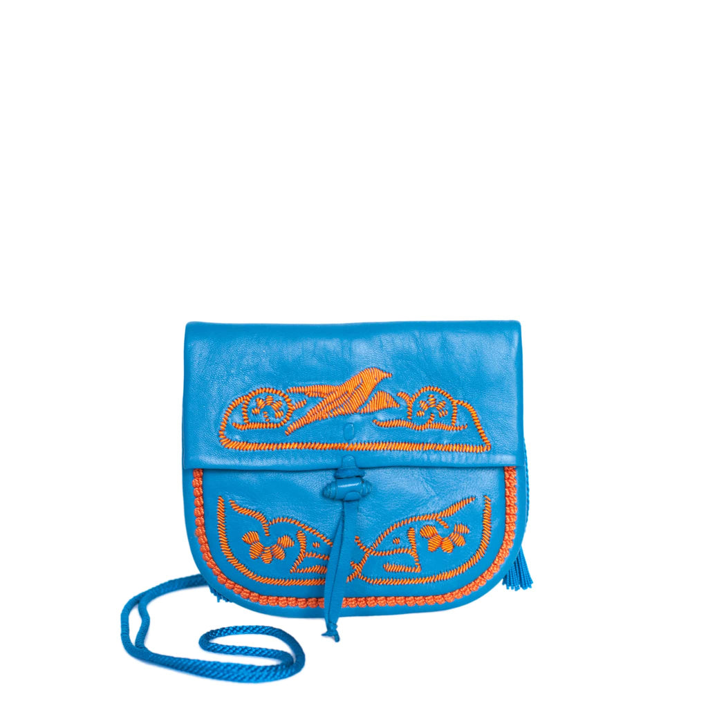 front view of handmade turquoise and orange abury mini berber bag