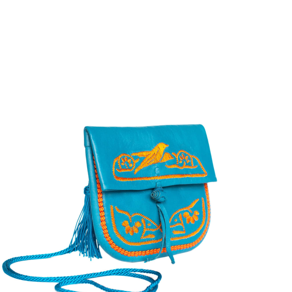 side view of handmade turquoise and orange abury mini berber bag