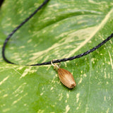 Oval golden grass black necklace by she is from the jungle