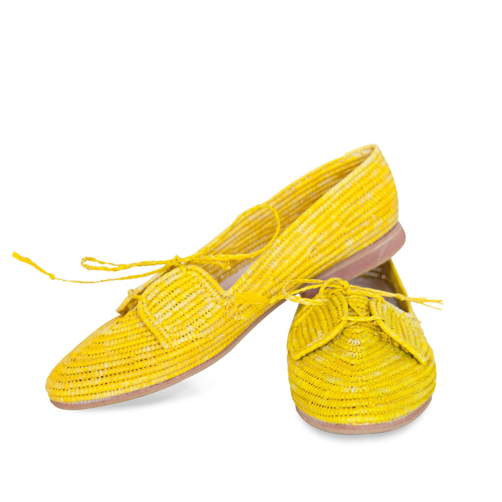 front side of handmade abury yellow raffia summer shoes with tassel