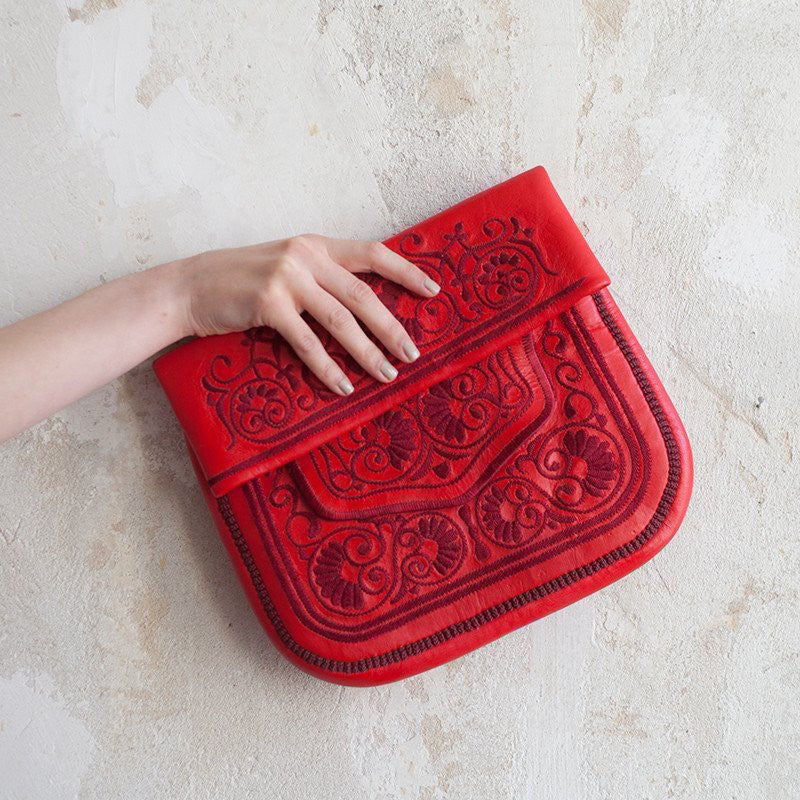 hand holding Red Leather Berber Bag ABURY Collection