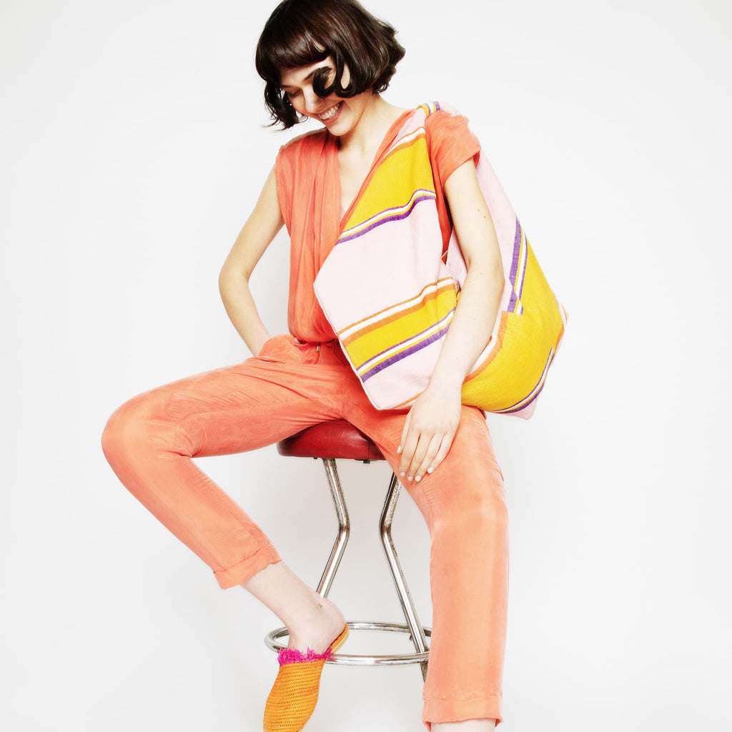 Model wearing ABURY cotton hobo bag in pink and yellow
