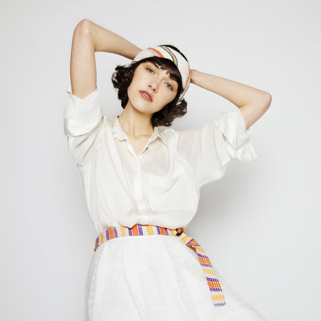 Model wearing ABURY colourful striped cotton belt