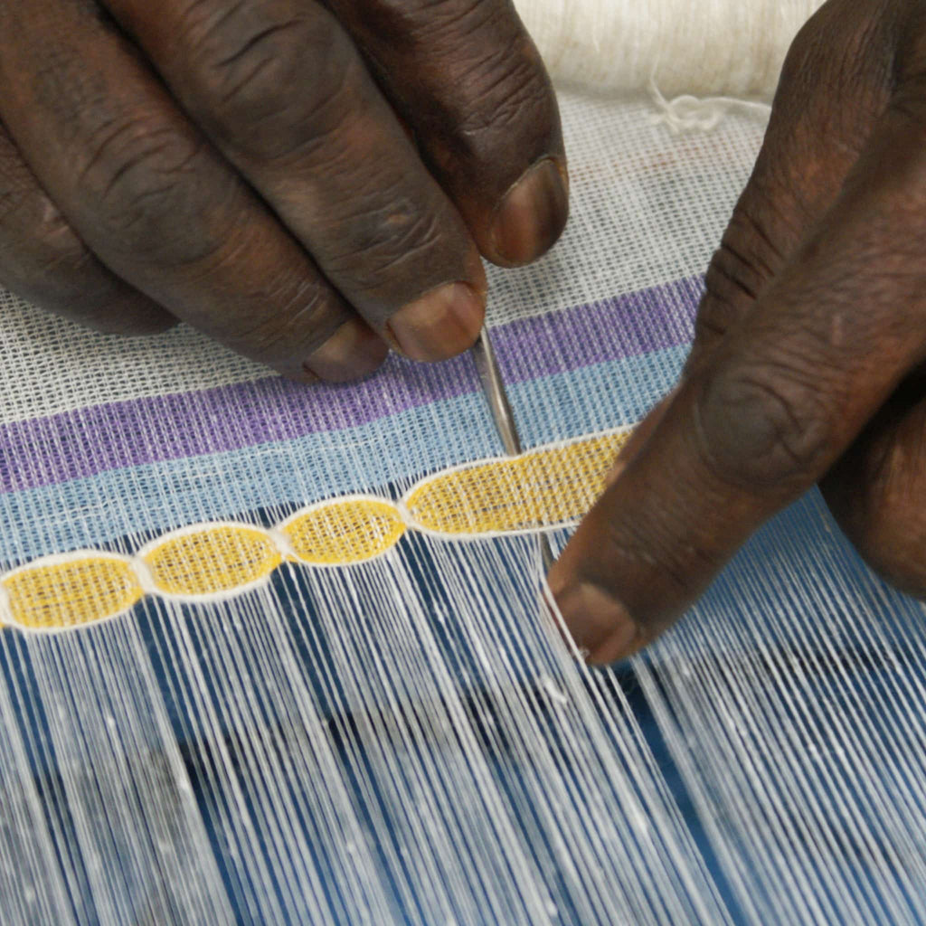 close up of the artisan weaving