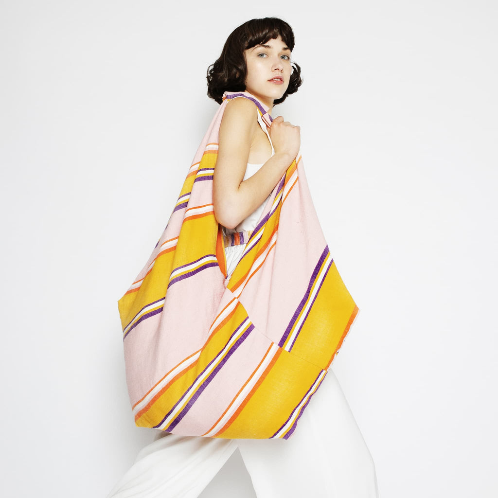 Model wearing ABURY XL Hobo Shopper Bag in Pink and Yellow