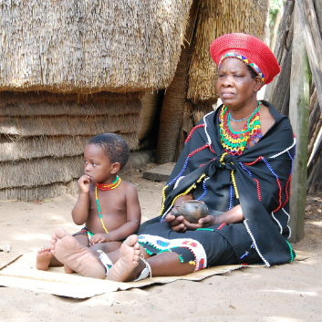 mwoman and child with traditional outfits from south africa