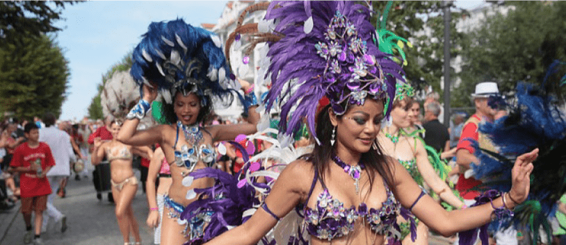 women dancing samba at a carnival