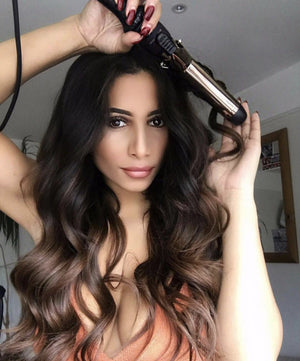 model with curling iron