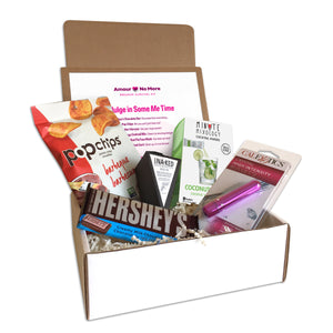 Breakup box featuring items to indulge in