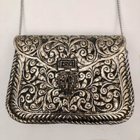ATRIA HAND CARVED METAL ORNATE BAG
