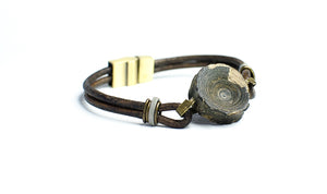 vertebracelet by Foxy Fossils featuring authentic fossil shark vertebra on leather straps with slide lock magnetic clasp