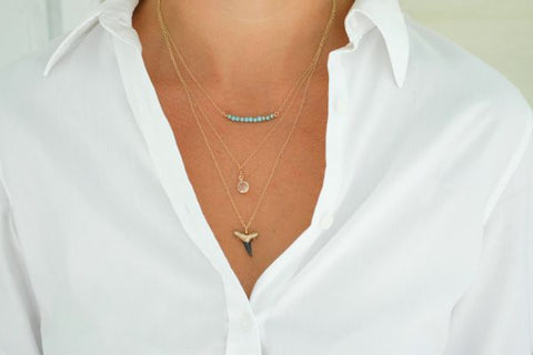 Dainty layered shark tooth necklace with quartz and blue stones handmade in Charleston, SC featuring a real fossil shark tooth with gold on the tip
