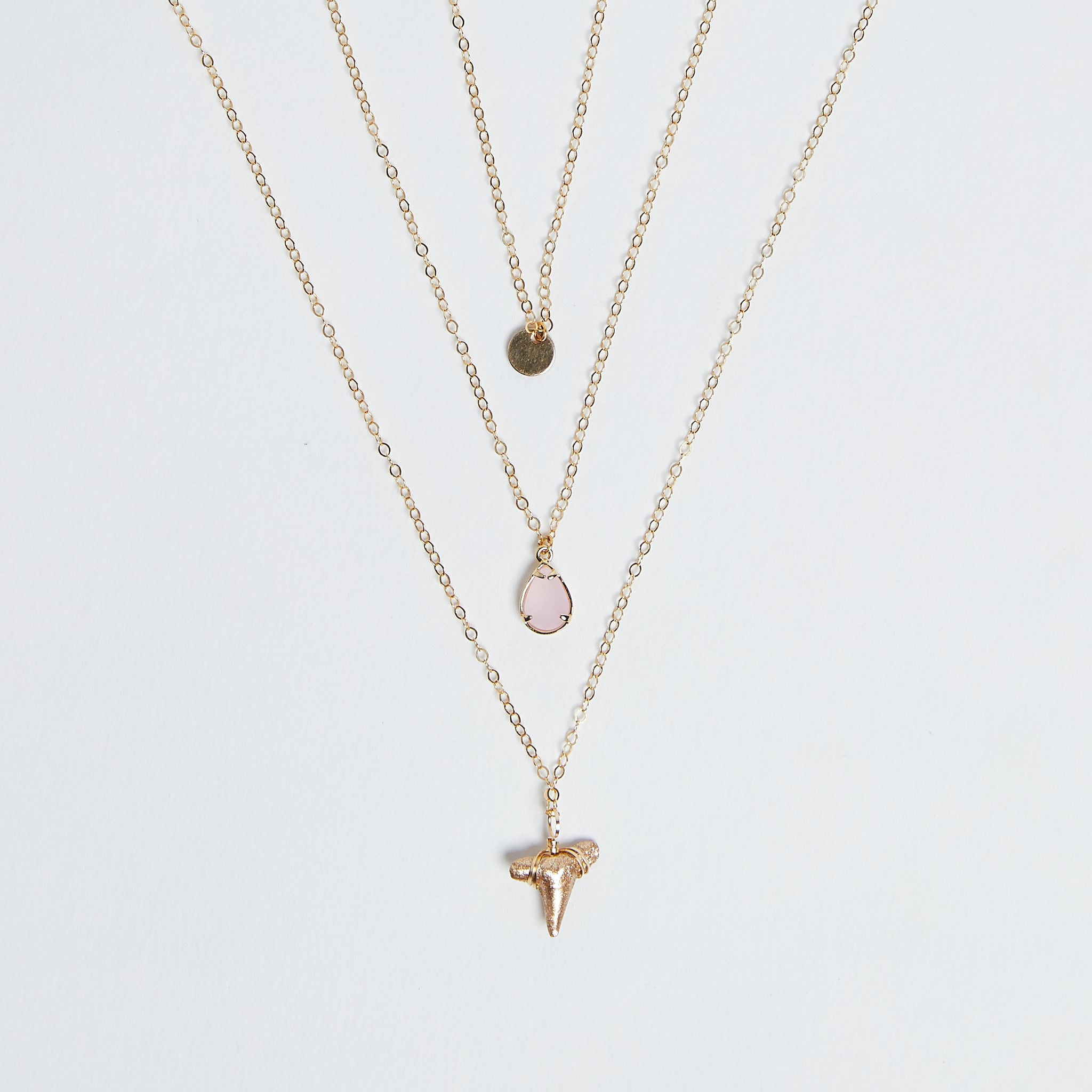 East Coast Vibes - Foxy Fossils 3 layer gold shark tooth necklace with light rose pink quartz crystal charm