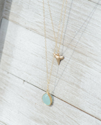 2 layer gold shark tooth and aquamarine pendant