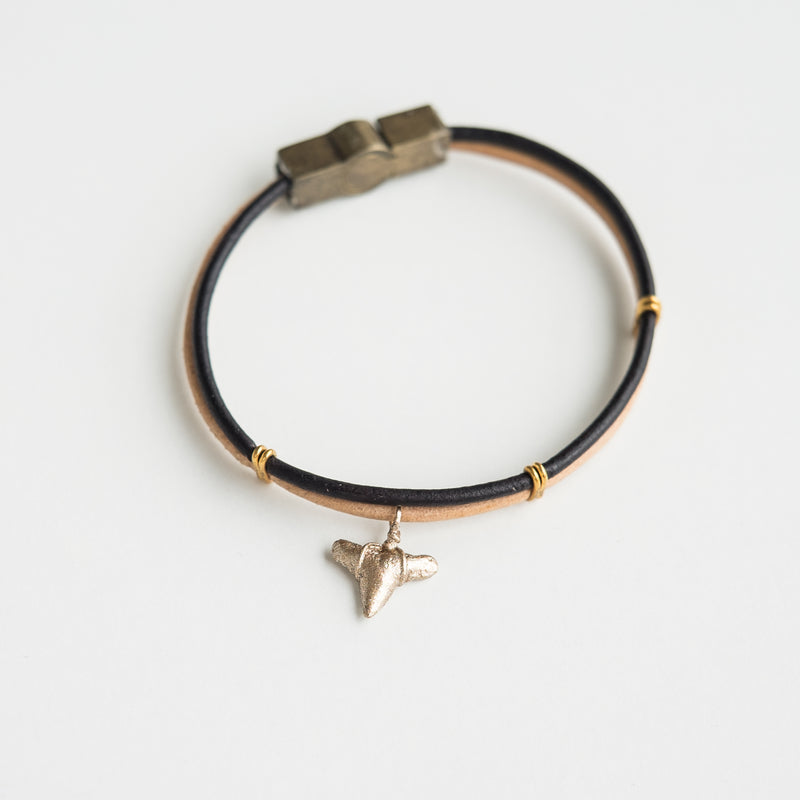 gold shark tooth charm bracelet on 2 tone leather straps