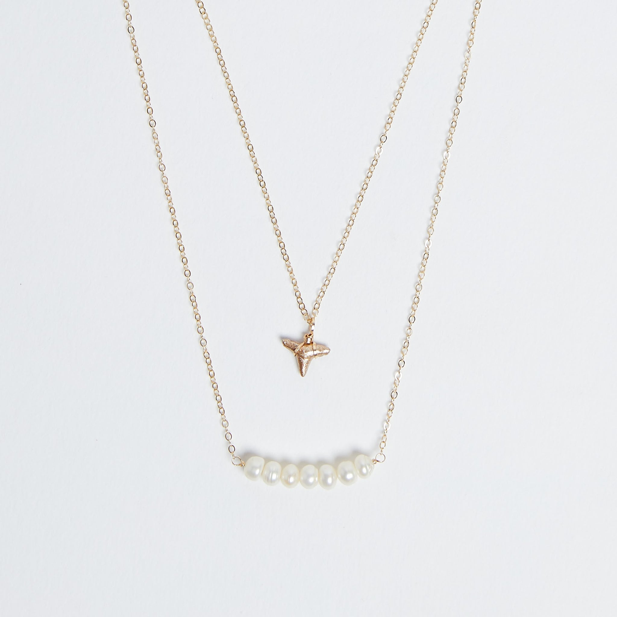 Saltwater Reign - Foxy Fossils double layer gold shark tooth necklace with freshwater pearls bar pendant