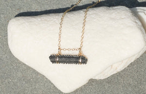 real fossil stingray barb bar necklace on gold chain and with 14k gold fill wire wrapping