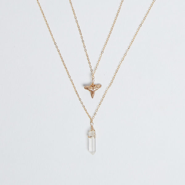 2 layer gold shark tooth necklace with quartz crystal pendant