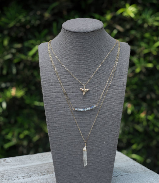 gold shark tooth layered necklace. crystal quartz layered necklace. boho chic quartz and fossil necklace; bohemian shark tooth necklace