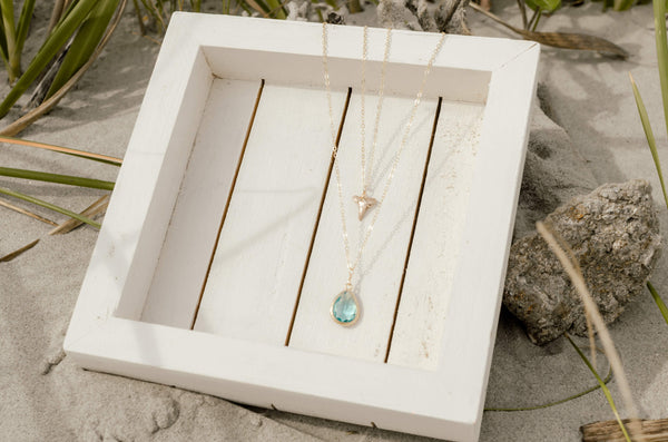 layered gold shark tooth necklace and aqua stone