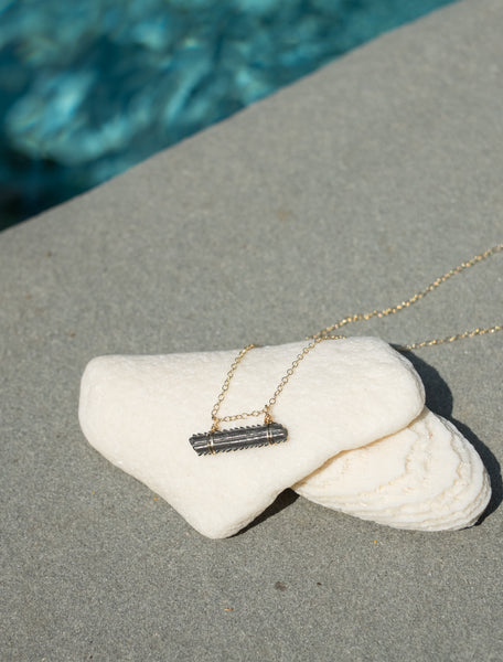 Dainty 14 Kt gold filled necklace with fossilized stingray barb sustainably collected in Charleston, SC