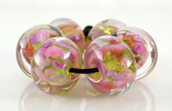 Amy Hall bead set with Pink Lipstick on Moretti 020 Light Green Grass, encased.