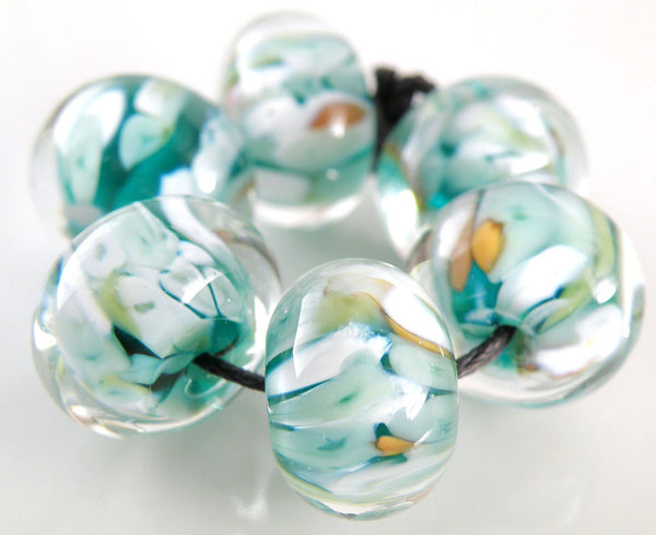 Amy Hall. Coy Koi on Moretti 026 Transparent Teal, encased in Lauscha clear.