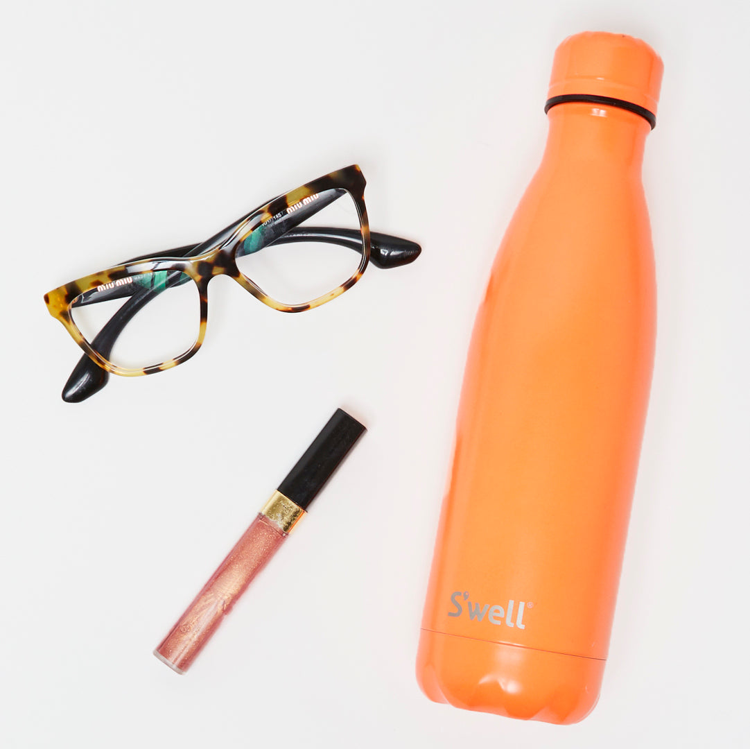 glasses, lip gloss, water bottle