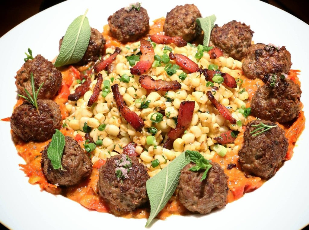 Meatballs made from grassfed beef served with a tomato sauce made from a variety of heirloom tomatoes. Paired with sweet corn quickly sauteed with bacon and finished with cayenne pepper/scallion/cilantro. Garnished with a variety of herbs: sage/rosemary/mint & mint flowers. The mint was my favorite.