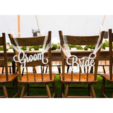 bride and groom wedding chair signs in white