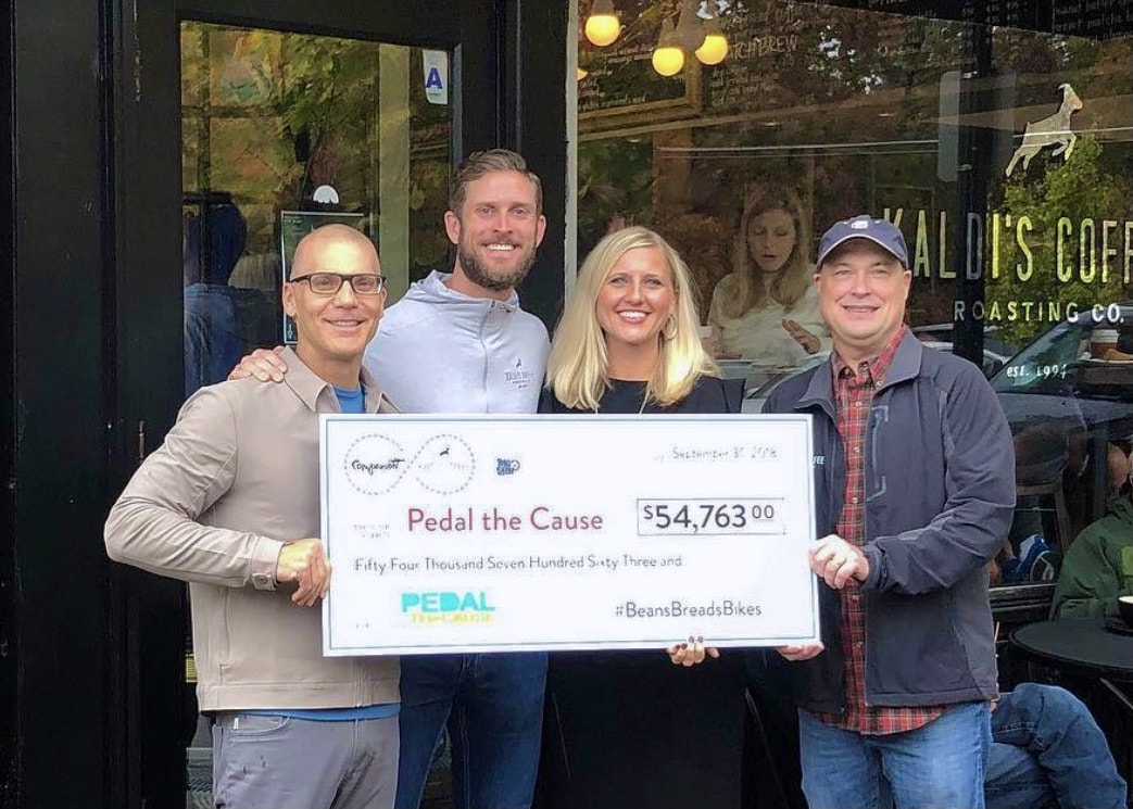 Kaldi's Coffee donating a check to Pedal the Cause