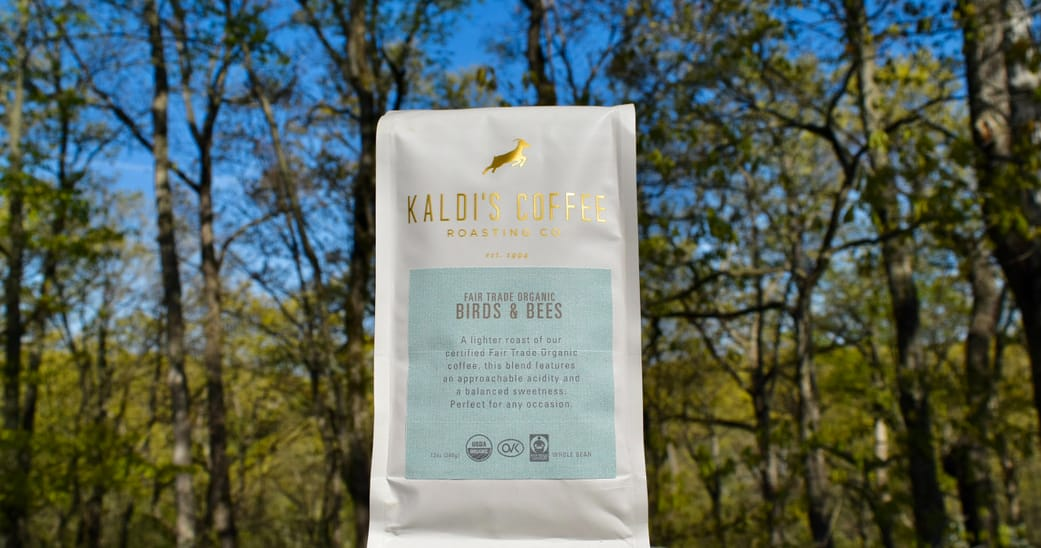 Birds & Bees coffee blend bag in front of trees