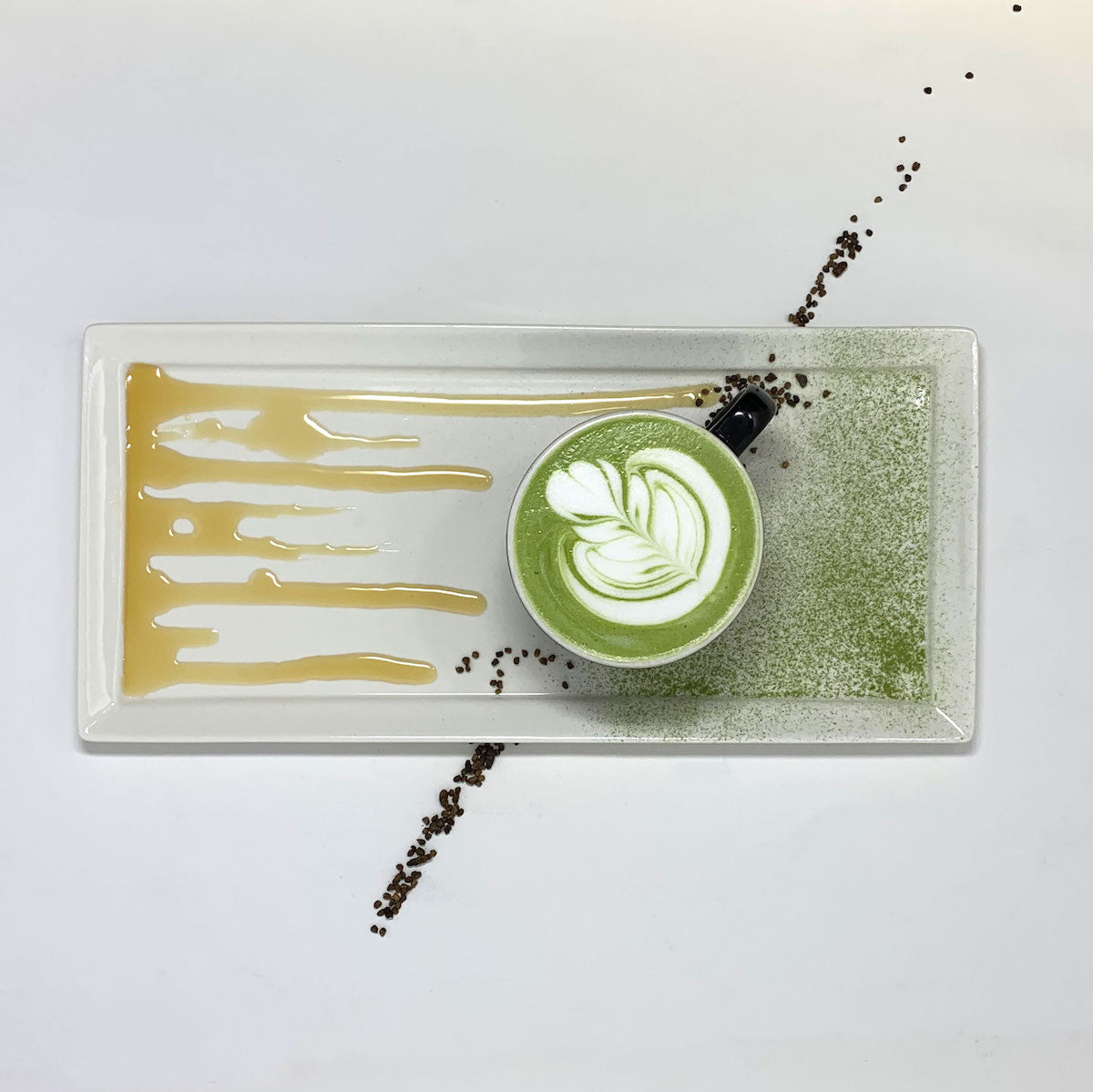 Cardamom Maple Matcha Lattee on a white plate