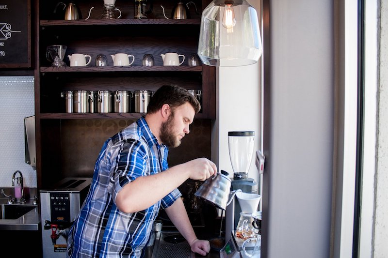 Kaldi's Coffee Barista Making a Pour Over Coffee In A Coffee Shop
