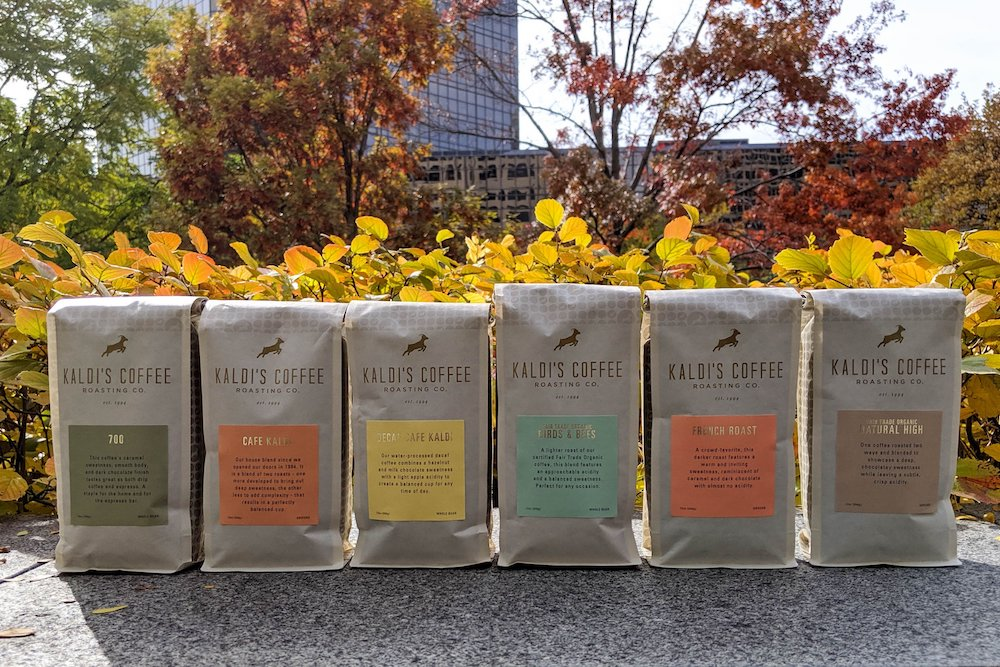 Bags of 12oz Kaldi's Coffee Blends Lined Up on a Crisp Fall Day