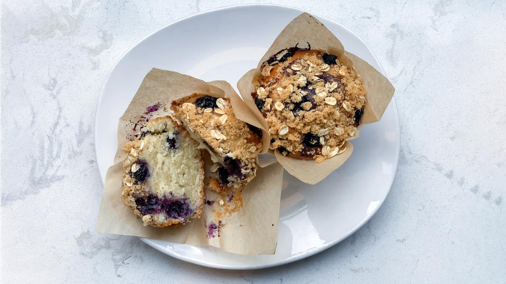 Blueberry muffins on a white plate