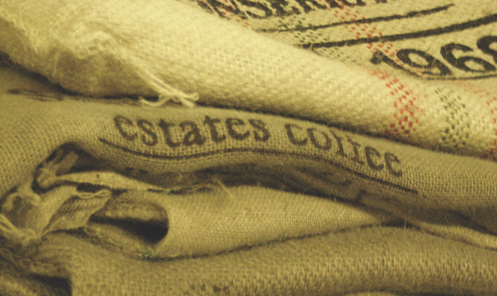Burlap coffee bags stacked
