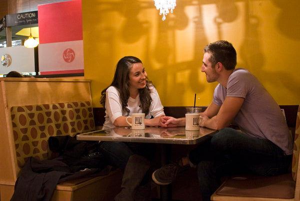 Danielle and Josh sitting at their table in Kirkwood