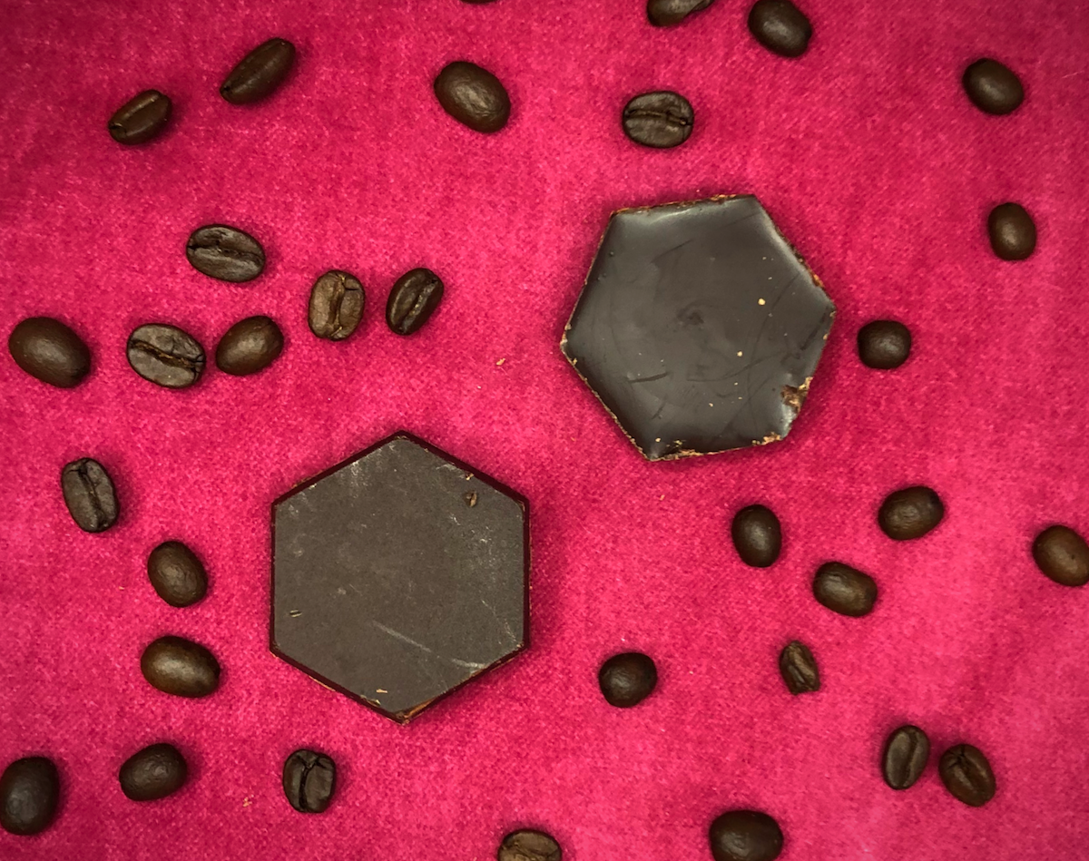 Chocolate Hexagons made with Birds and Bees coffee blend on a red pillow